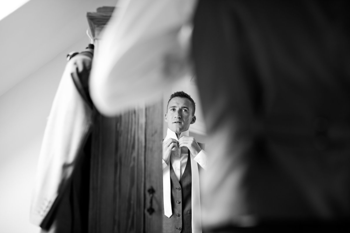 groom getting ready at the oak barn devon august