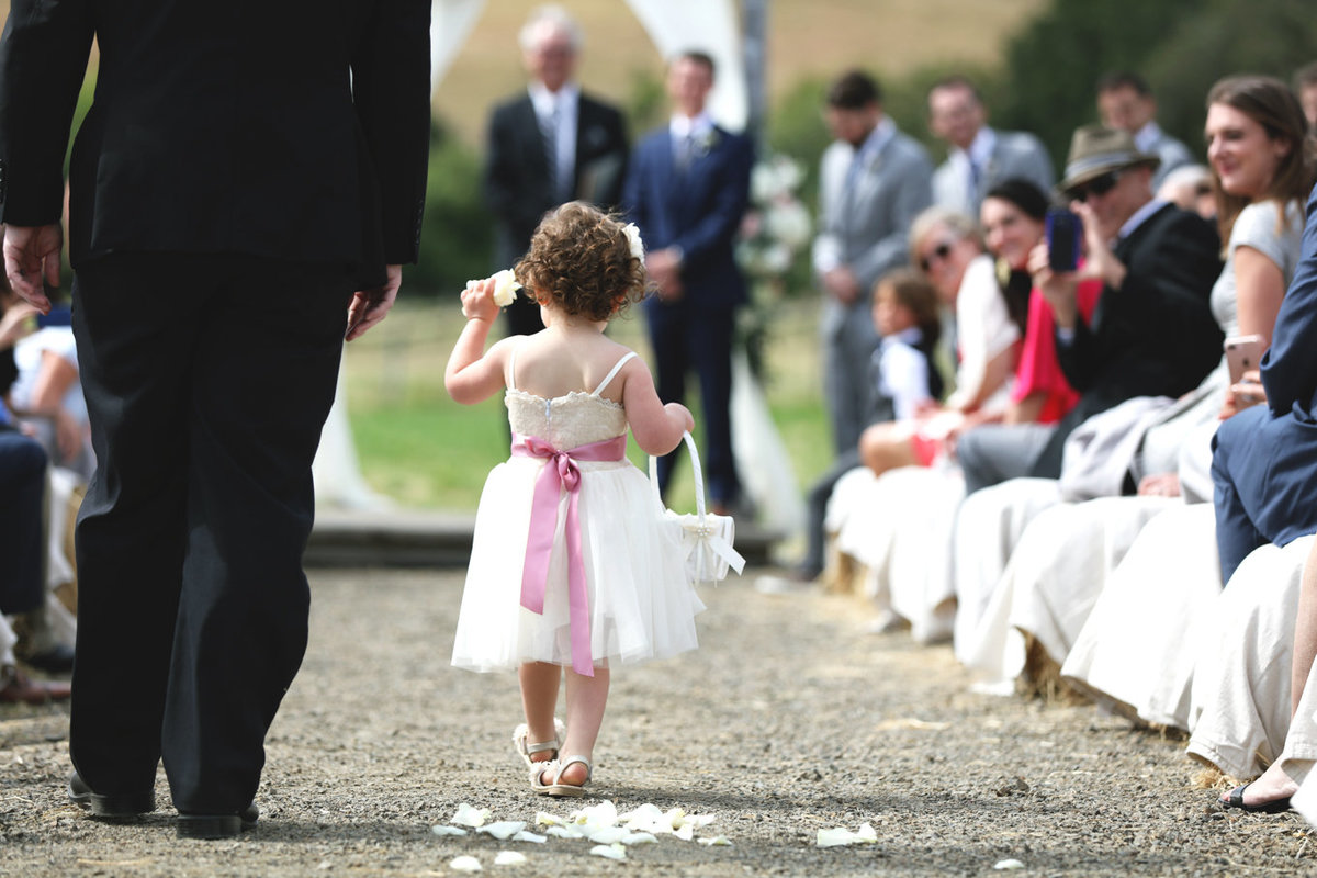 Napa Valley Photographers, the Cute Flower Girl Walking Down the Aisle