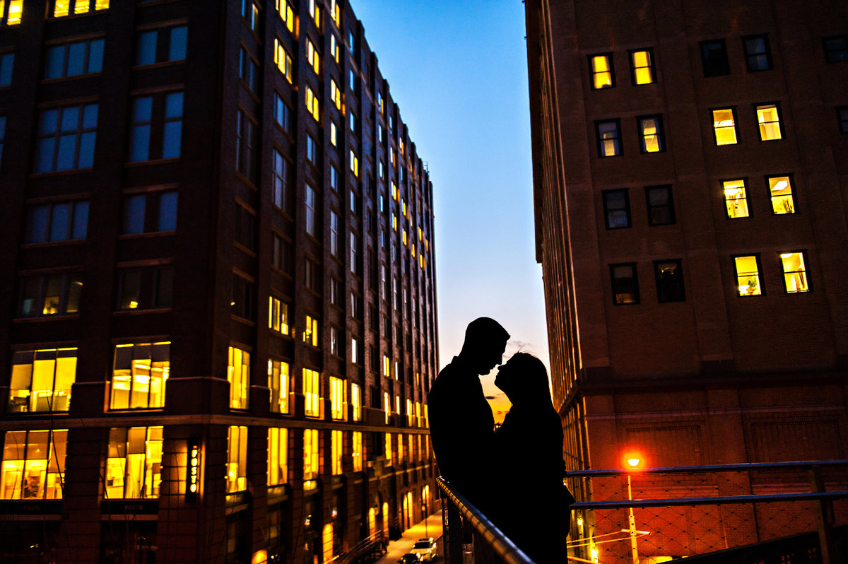 A NYC silhouette cityscape on an engaged couple.