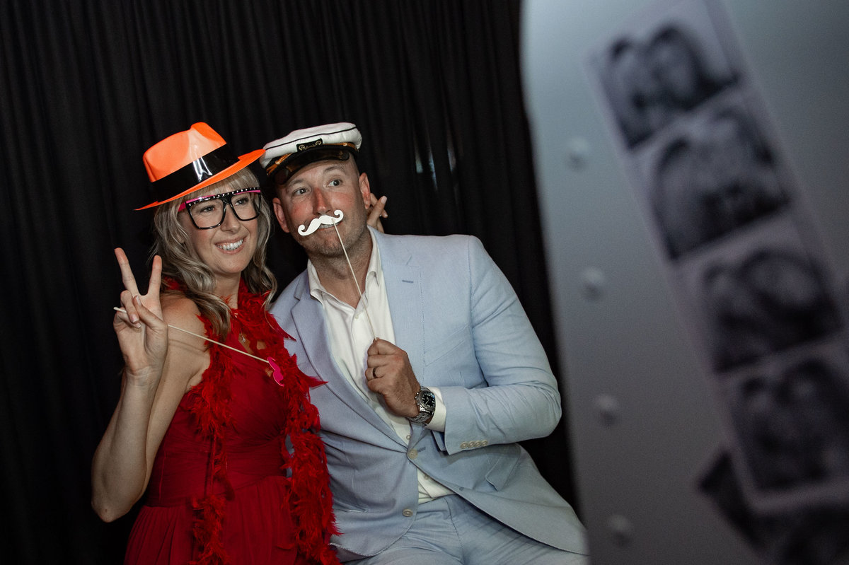 guests pose silly in photo booth