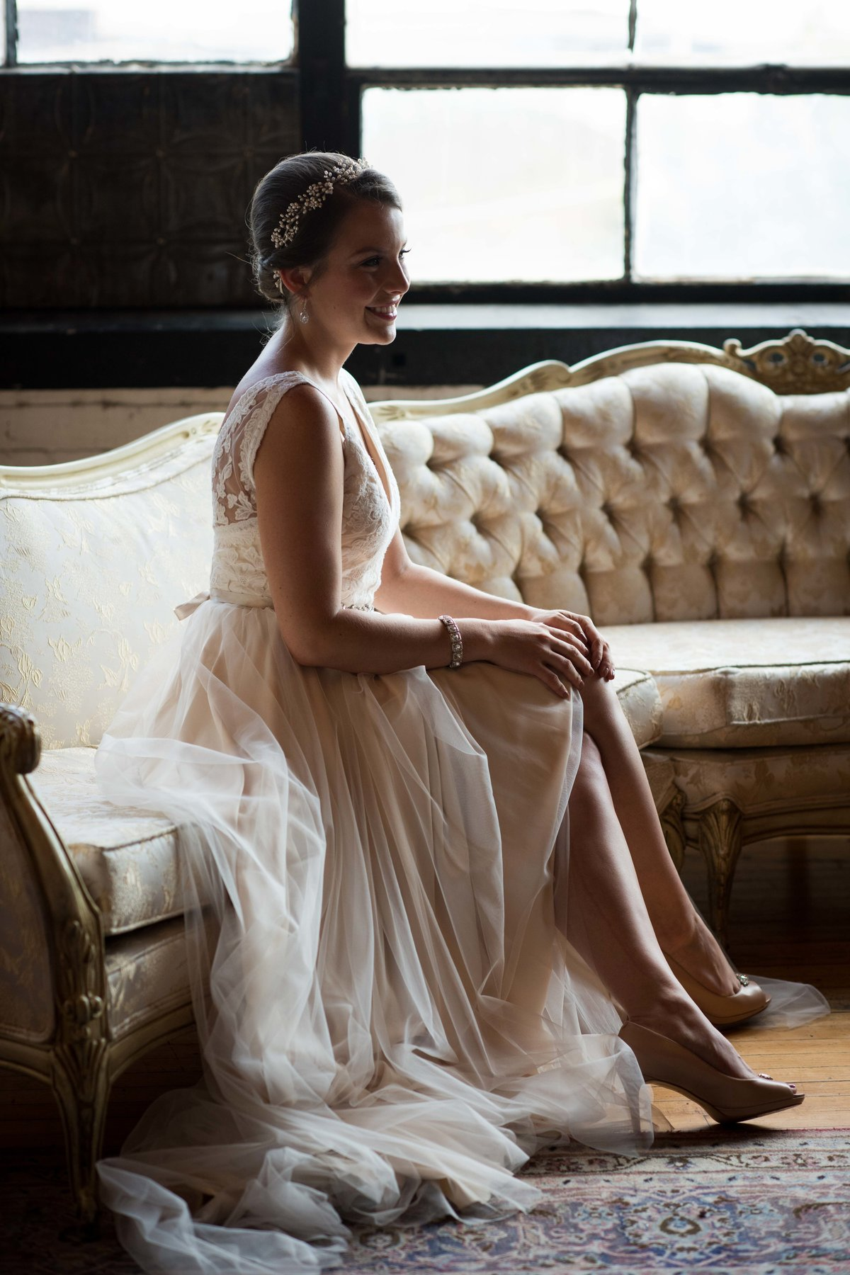 Bride seated on sofa, Chicago wedding, Salvage One.