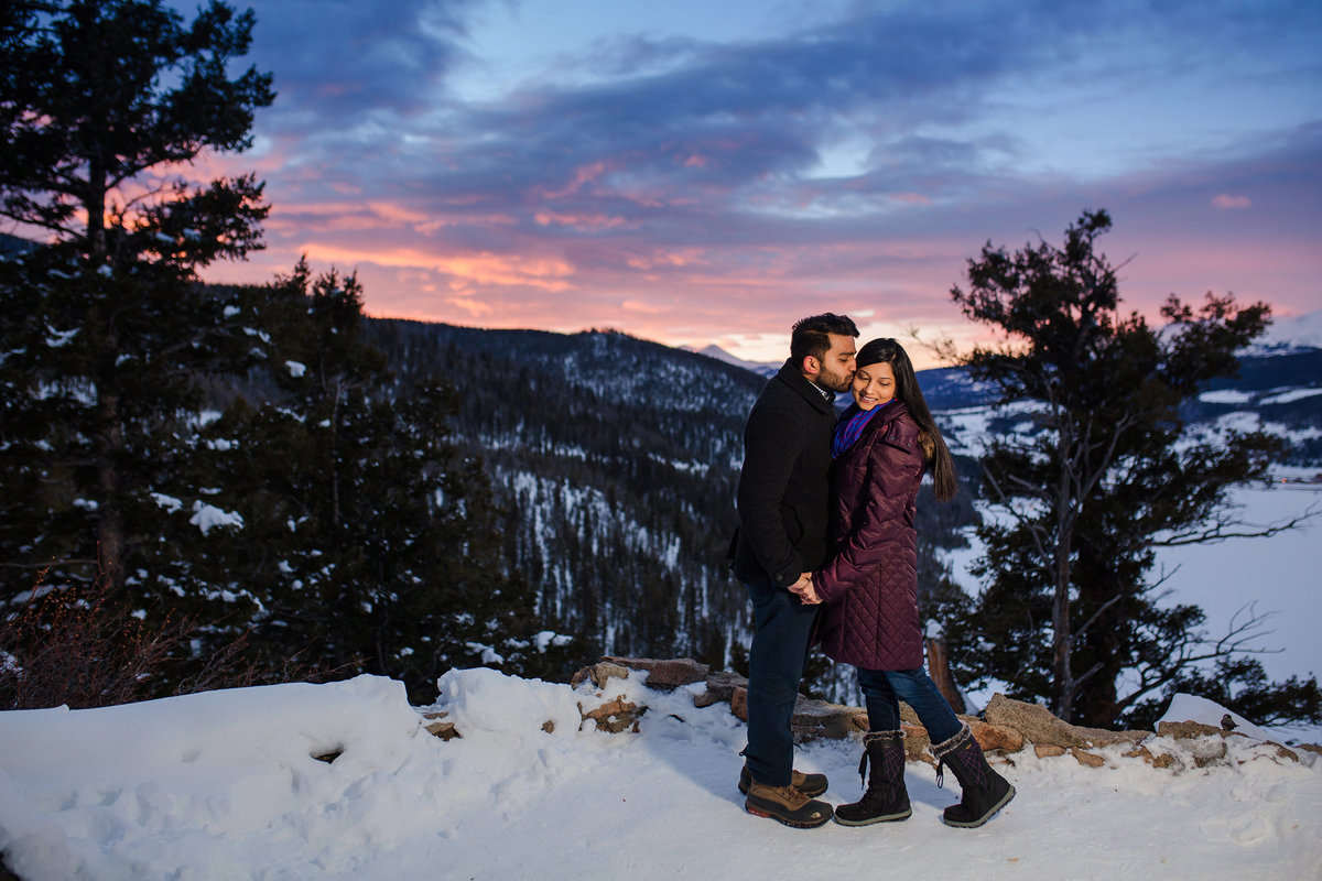 engaged couple at snowy Sapphire Point