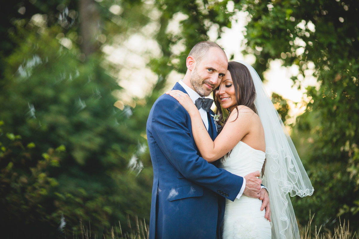 couple embracing at styal lodge in cheshire