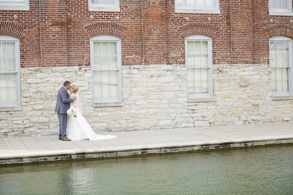 A bride and groom on the canal in Indianapolis