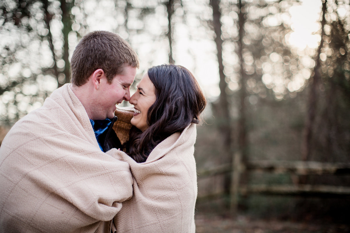 Wrapped up in a blanket together  by Knoxville Wedding Photographer, Amanda May Photos.