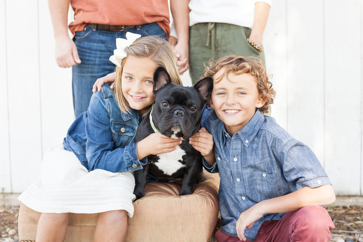 kids pose with their dog on national pet day for holiday family photos in clovis california