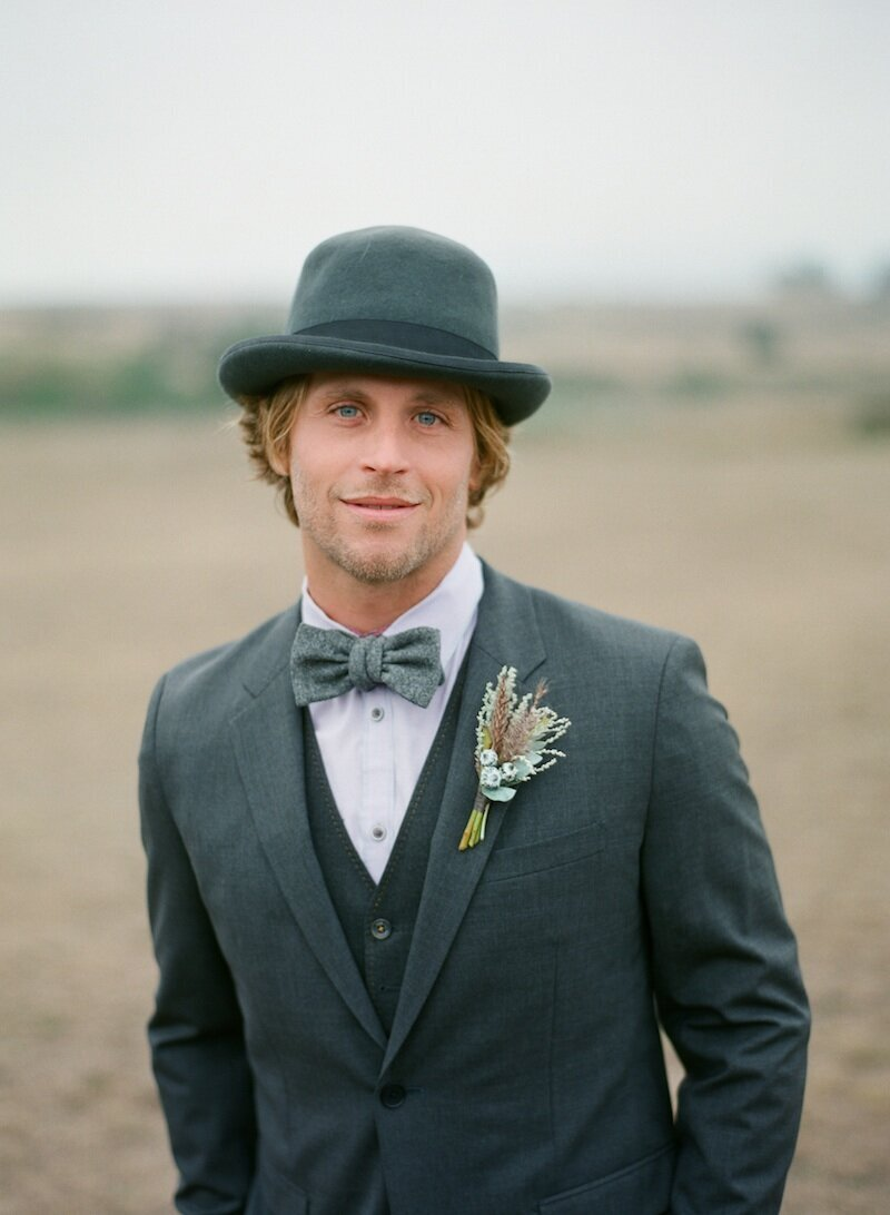 Bodega bay groom mens hat gray suit  boutonniere