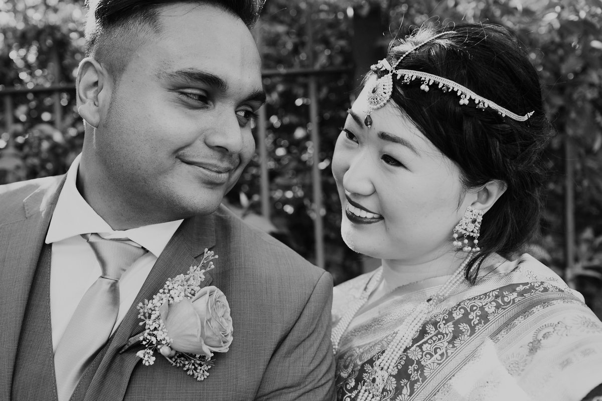 Black and white photo of newlyweds at Wascana Centre.