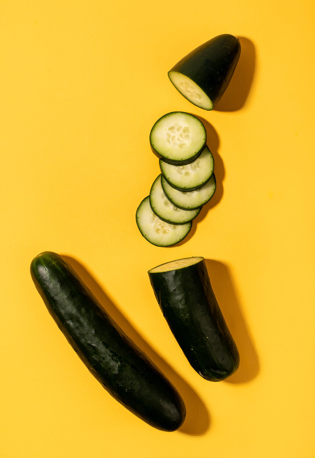 sliced cucumber on yellow
