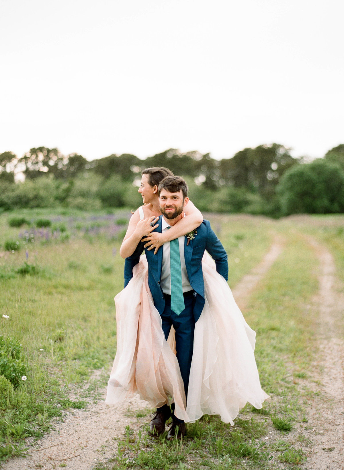 piggy back ride bride and groom adventure wedding nantucket