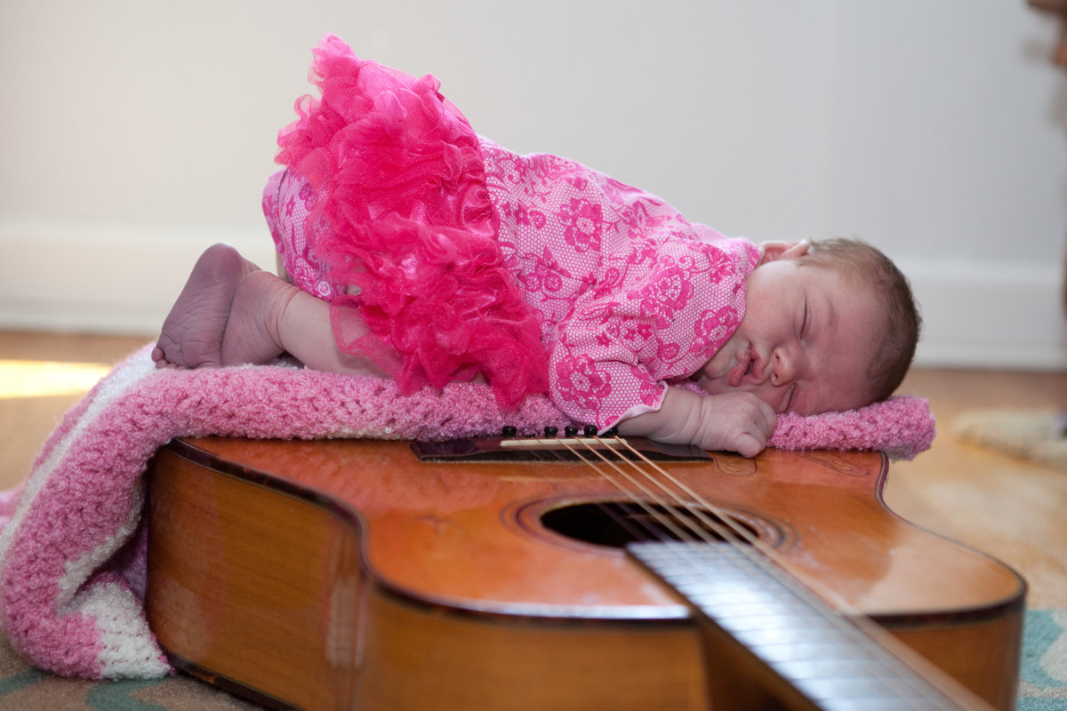 baby portrait on guitar