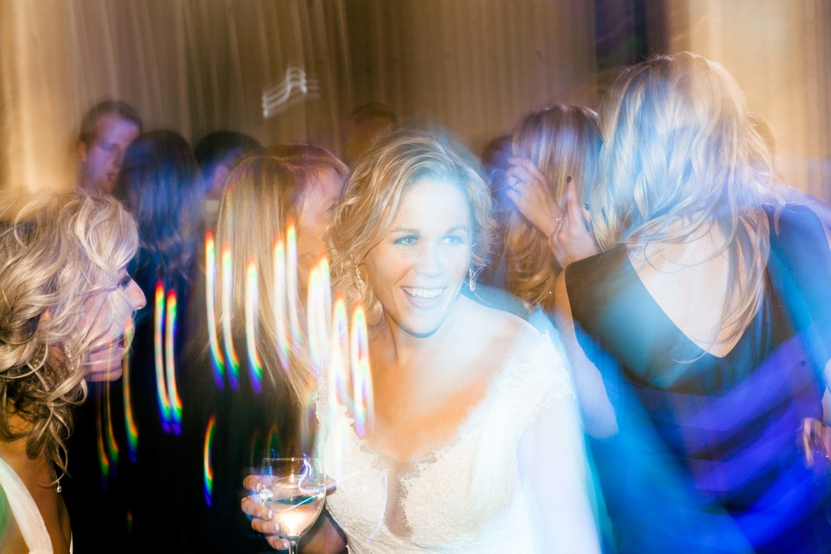 Bride laughs as she enjoys her wedding at Omni Severn