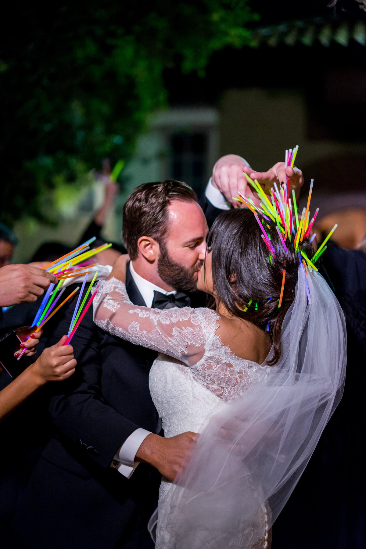 Bride and groom exit wedding reception with glow sticks grand departure at The Witten Museum venue