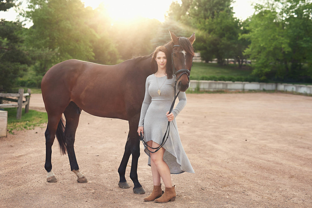 Whimsical senior portrait with horse