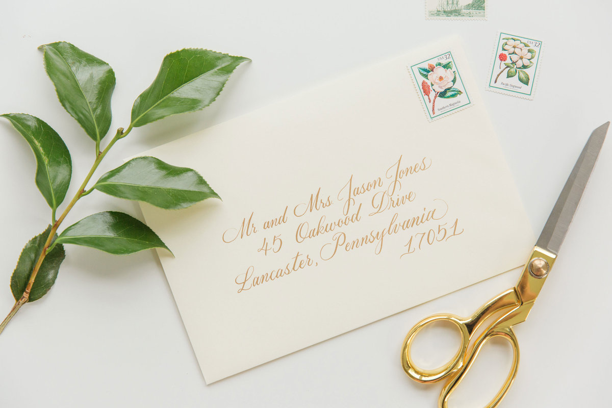 Custom envelope for wedding invitation with goldink