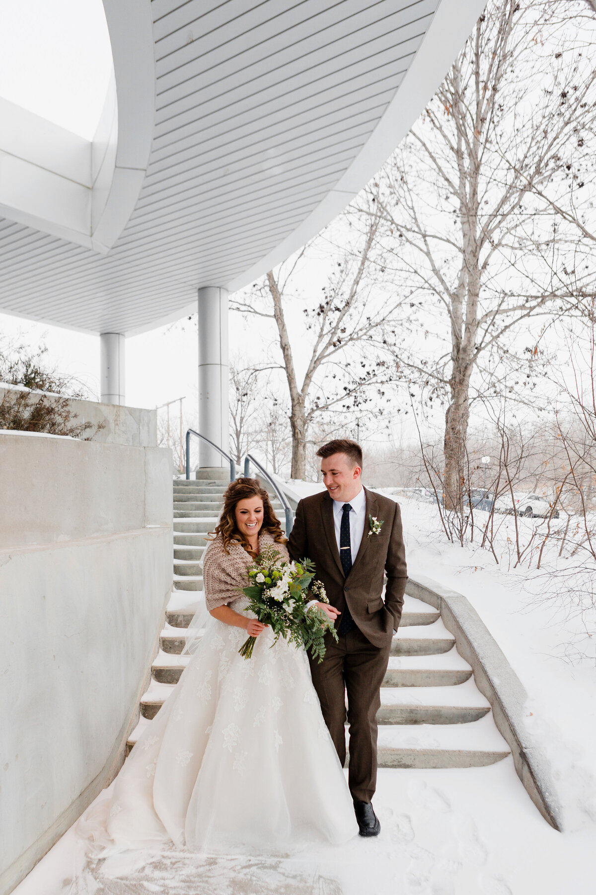 Winter wedding in Regina outside the IMAX for photos