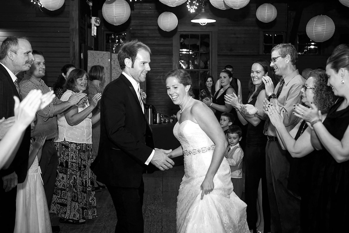 black and white photo of bride and groom contra dancing at Vermont bar reception