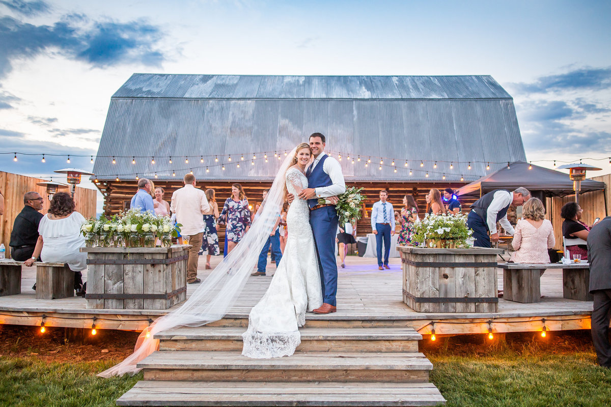Strawberry-Creek-Ranch-Wedding-Ashley-McKenzie-Photography-Romantic-Mountain-Affair-Navy-Blush-Colorado-mr-and-mrs-on-deck