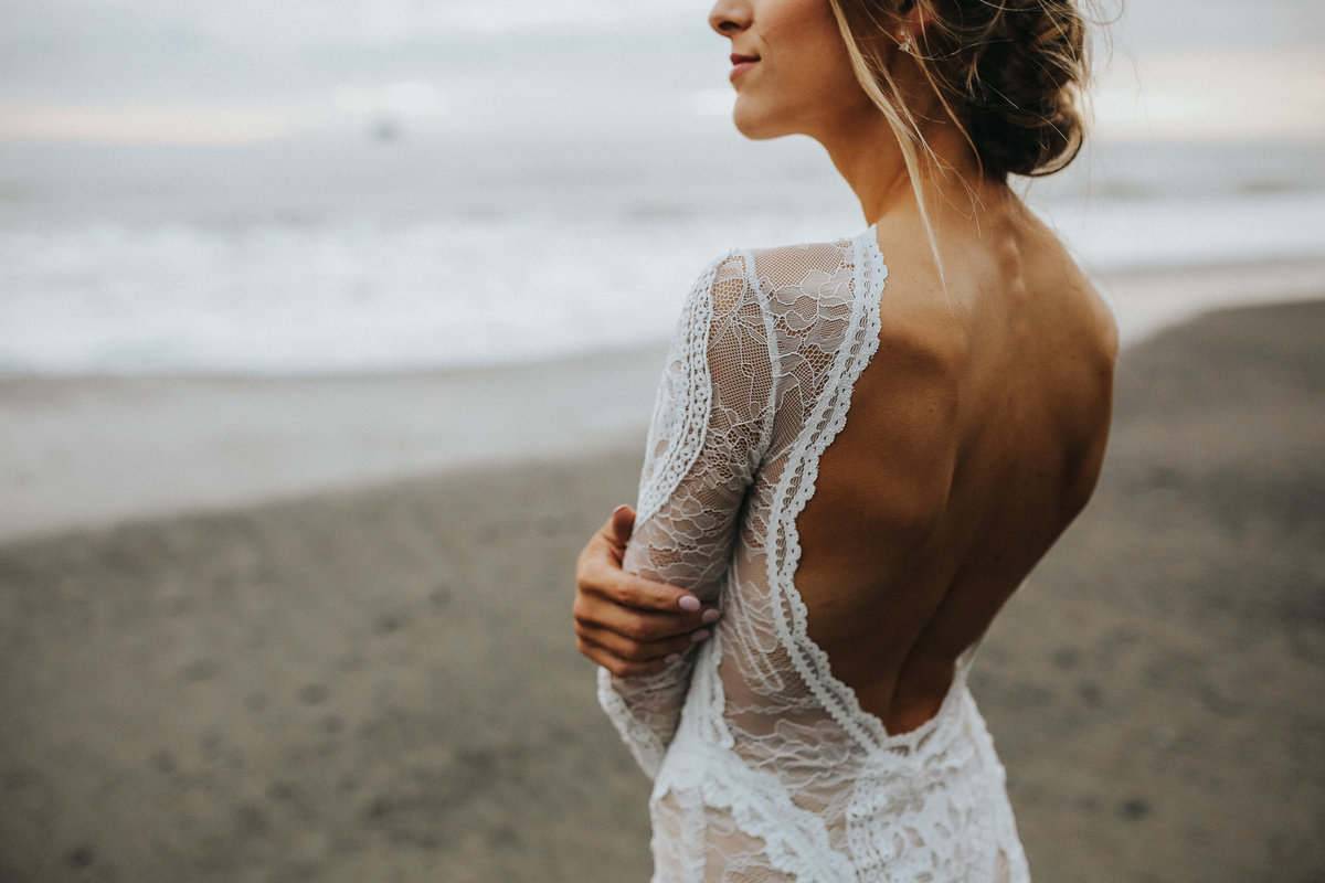 Bridal portrait during her elopement at Rialto Beach  on the moody beaches of La Push Washington