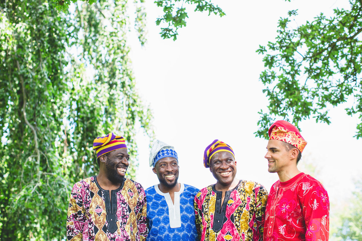 nigerian wedding groomsmen with colourful outfits