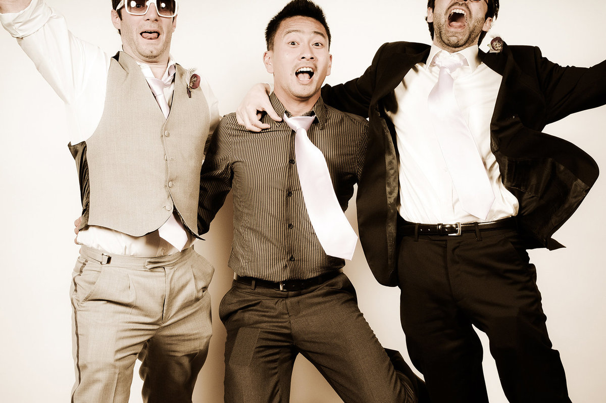 0002-Photo-Booth-Rental-at-Wedding-Reception-Guests-Having-Fun