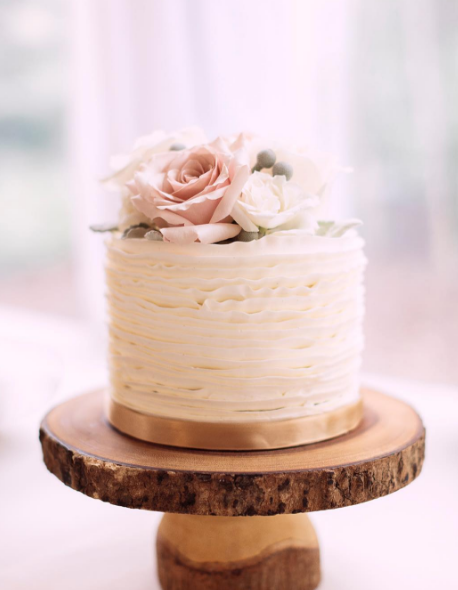 Whippt Wedding Buttercream Ruffle Cake with Wooden cake pedestal rental