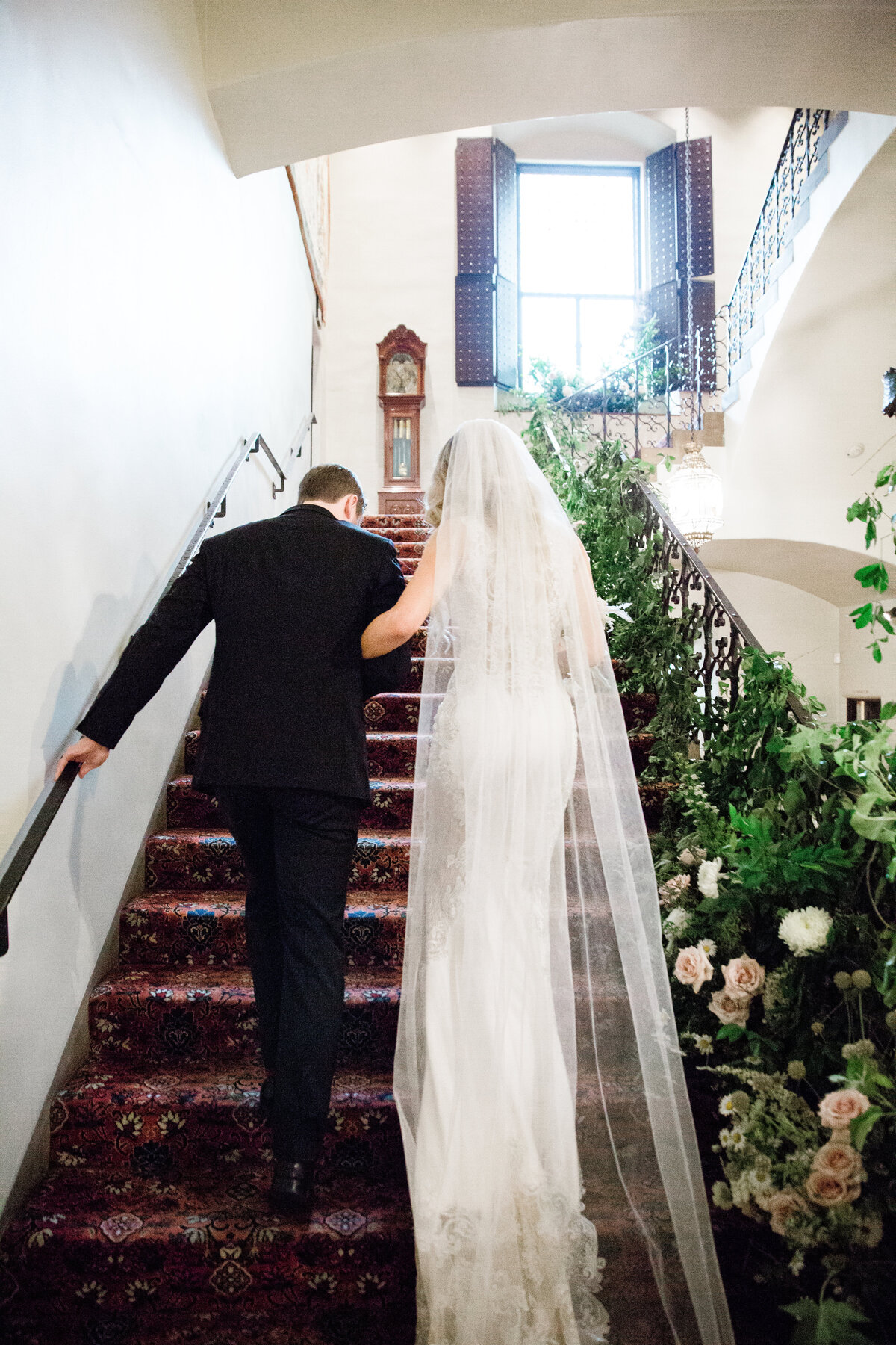 bridew and groom on floral staircase