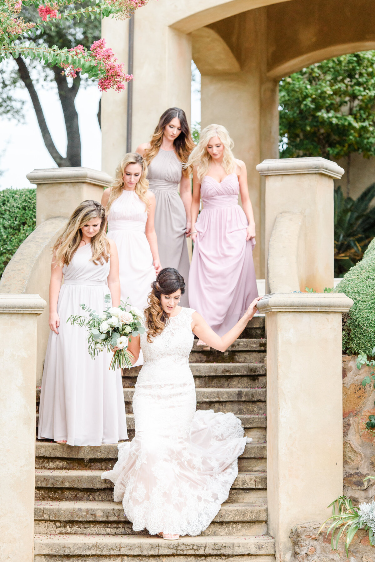 bride and bridesmaids on staircase