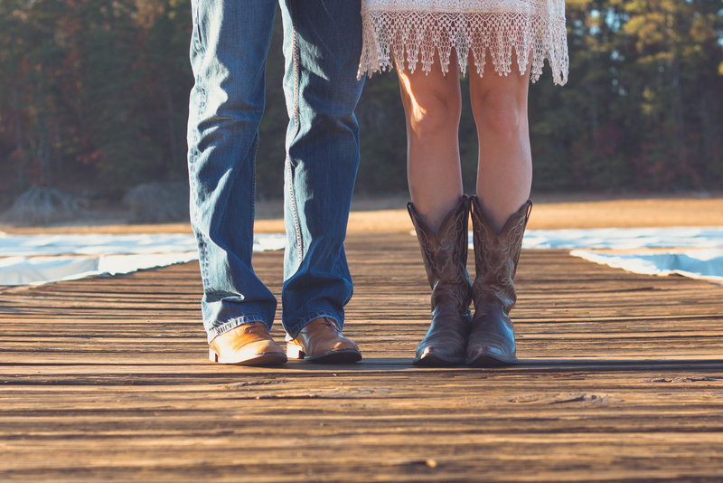 couple portrait shoes shot by the dock and lake