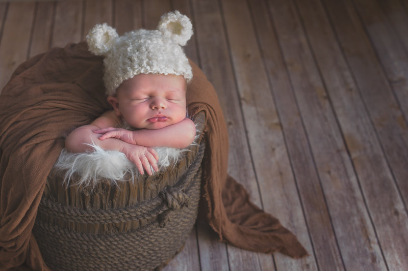 Newborn wearing teddy bear hat photo by Plume Designs & Photography of Scottsdale, Arizona
