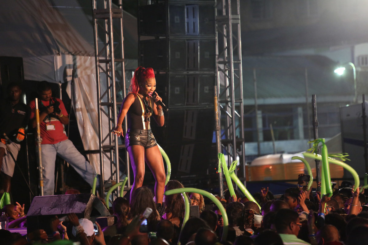 Female soca star sings for a crowd. Photo by Ross Photography, Trinidad, W.I..