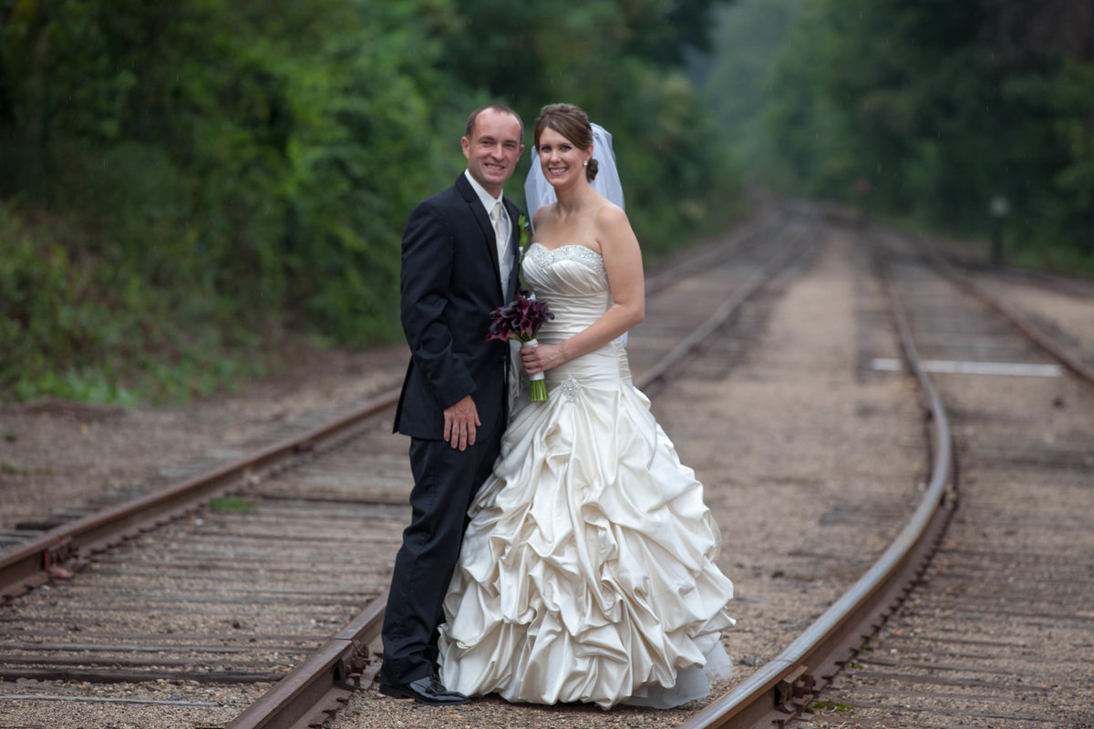 Bride and groom on railroad tracks
