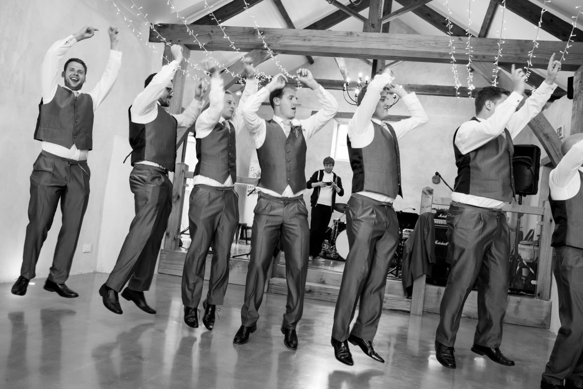 groomsmen and ushers dancing at upton barn