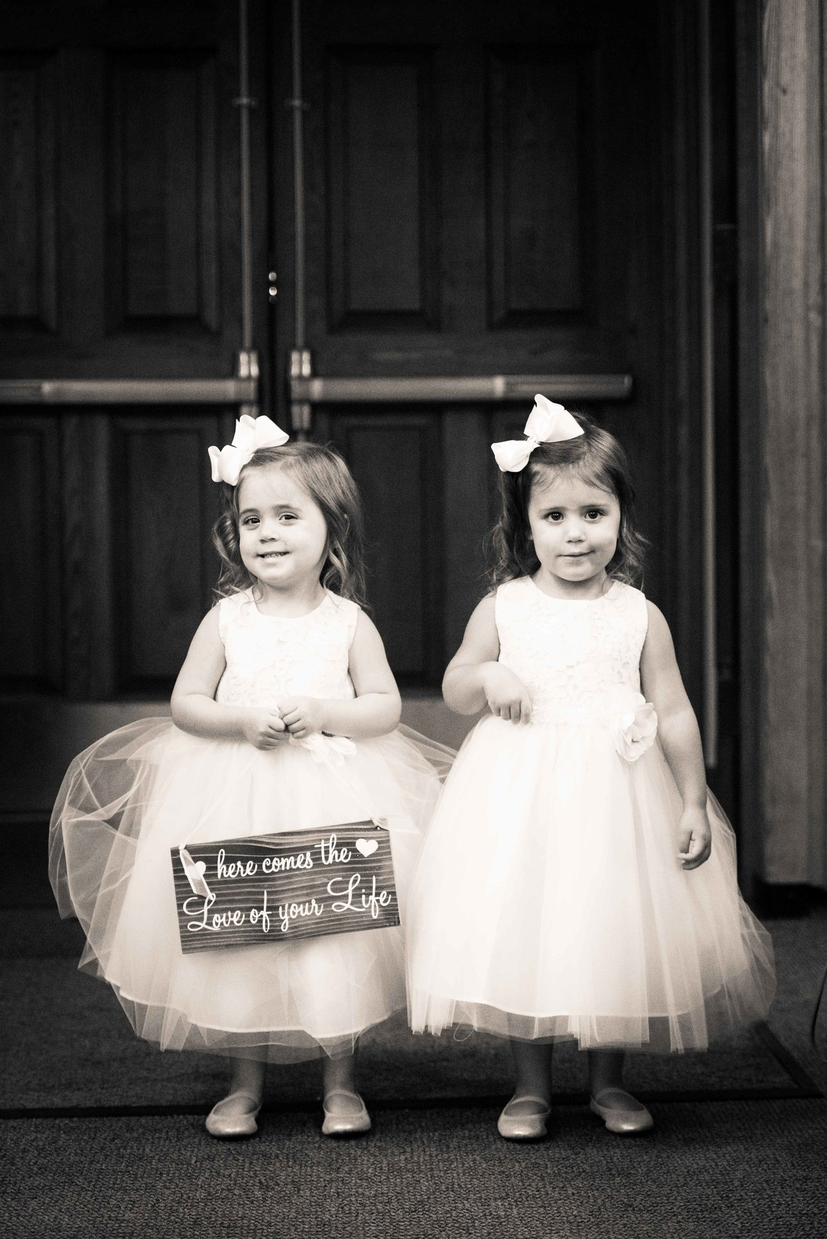 Flower girls prepare for wedding ceremony, Chicago IL.