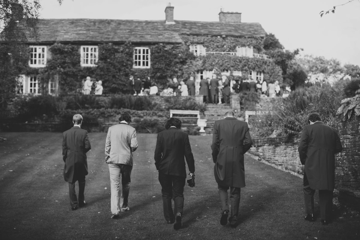 the guys walking in a line at hill top country house