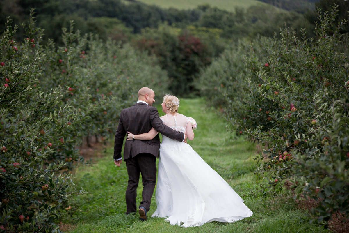 among the apples at the corn barn wedding in october devon