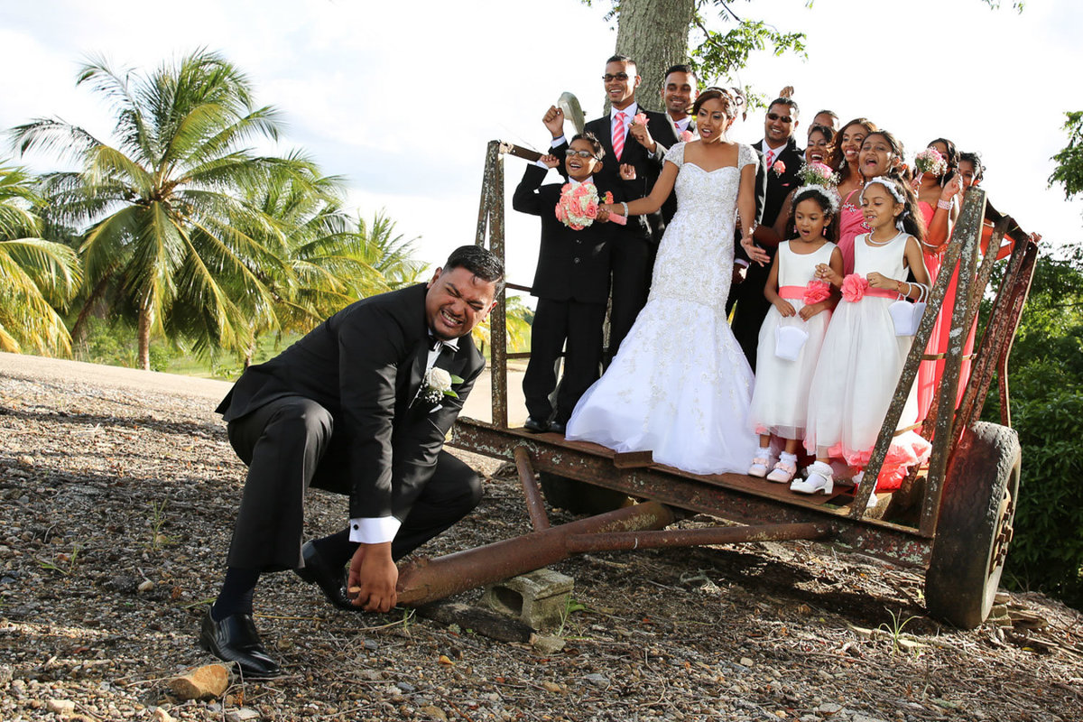 Fun, posed shot of groom with bride and wedding party. Photo by Ross Photography, Trinidad, W.I..