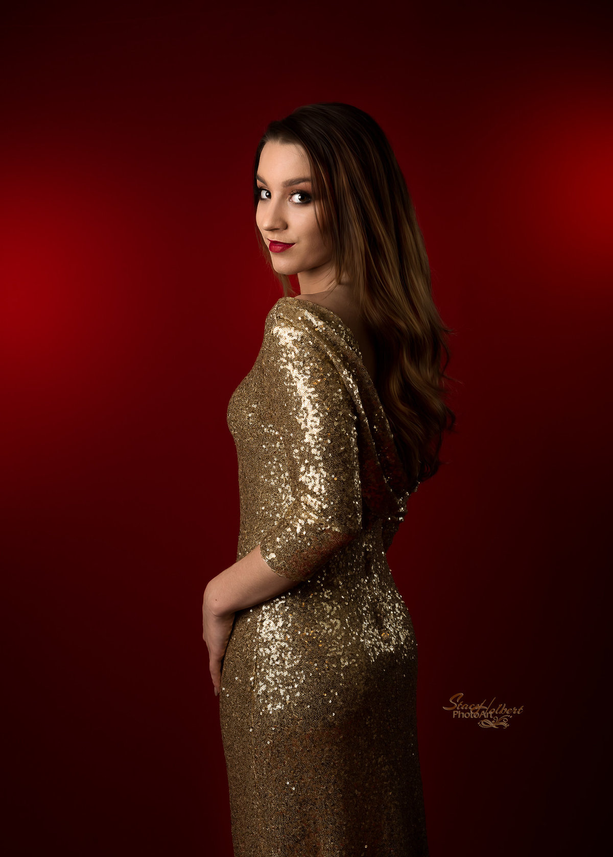 Senior girl glamour portrait with red backdrop and gold sequin dress.