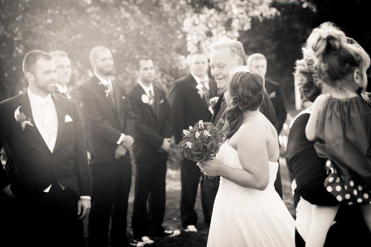 Wedding ceremony, father escorts bride down aisle, Chicago.