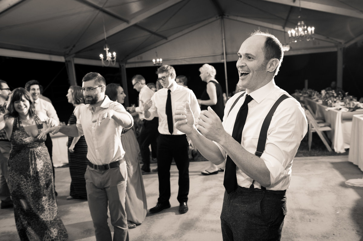 Guests at wedding reception cheer on dance floor, Hocking Hills OH.