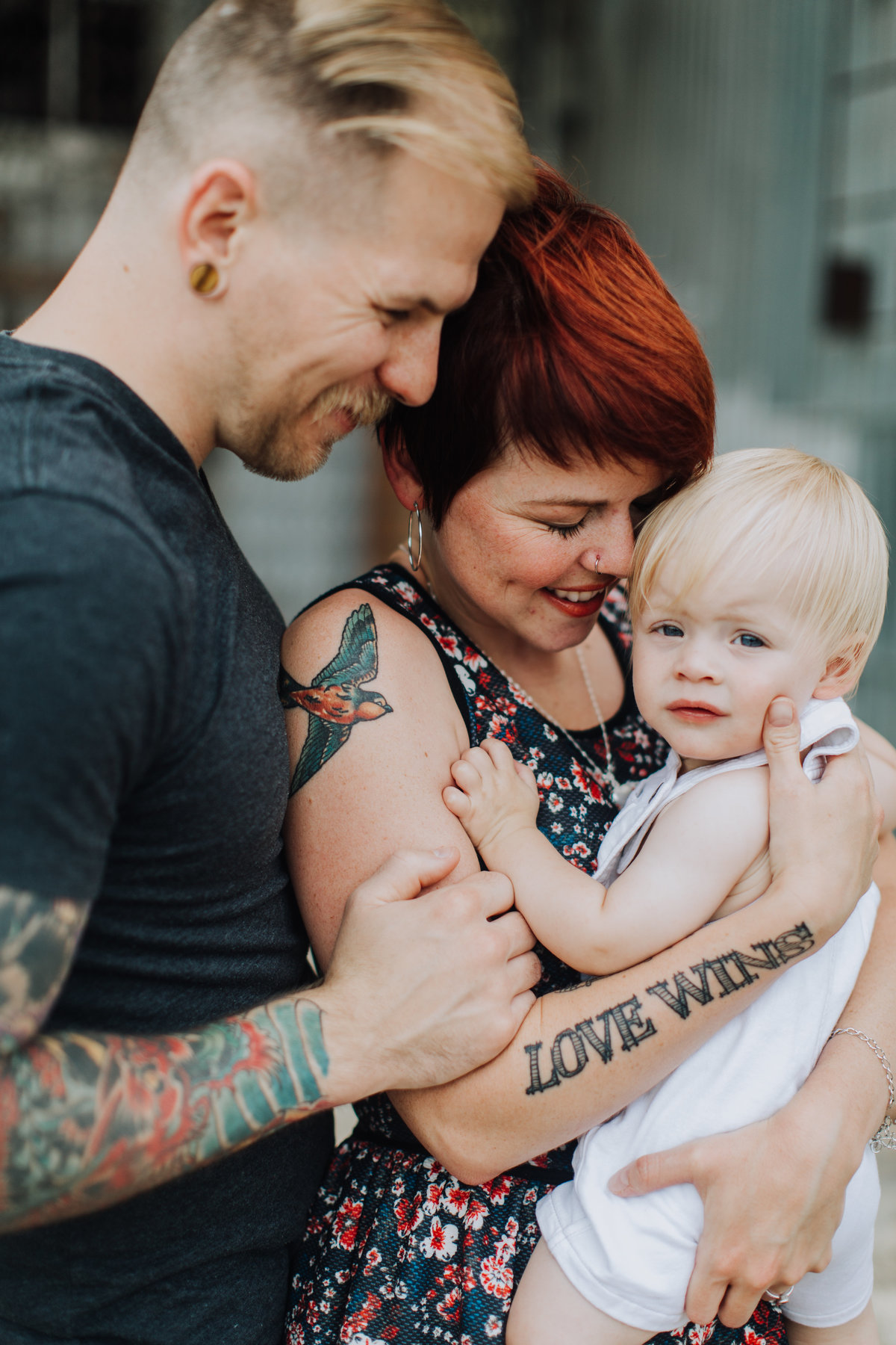 tattooed family smiling with baby