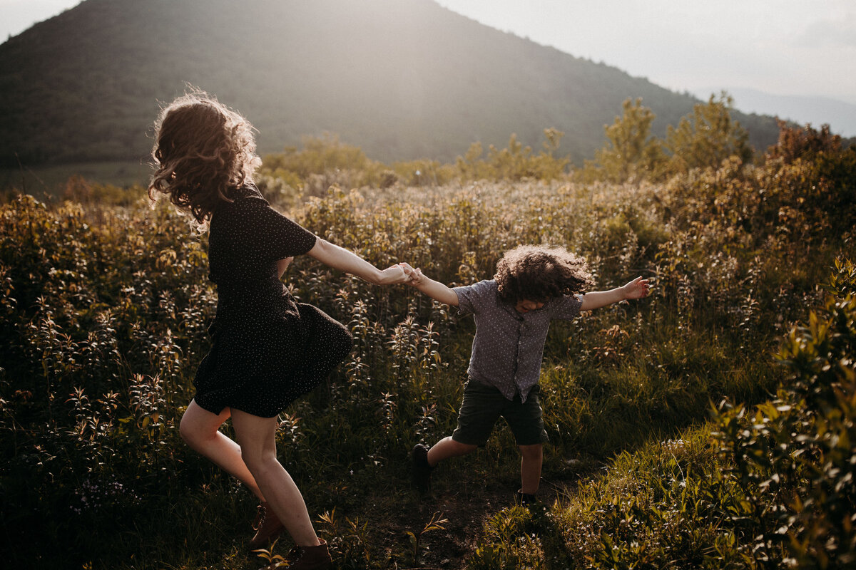 mom and son playing in the asheville mountains