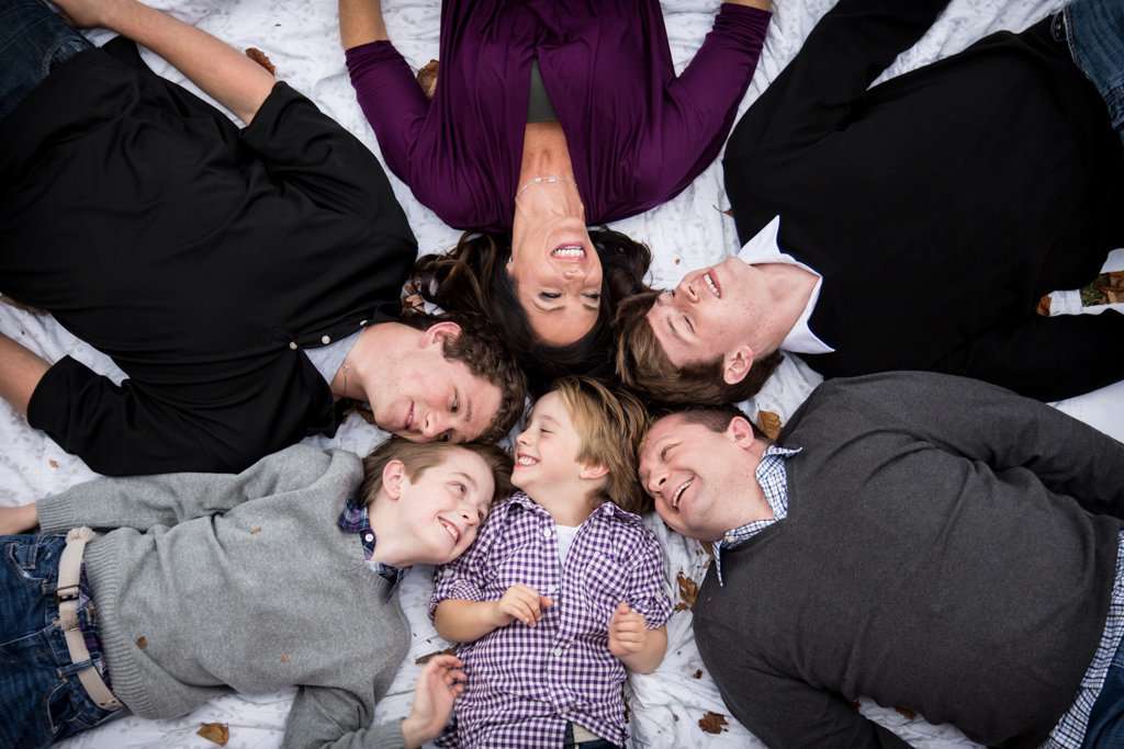 Family Laying on Ground for Family Picture