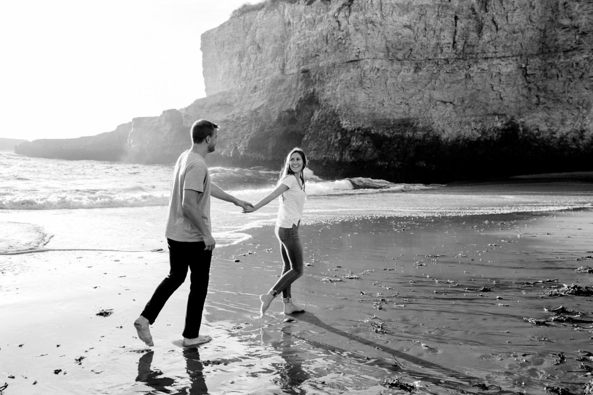 Engagement session for young couple, dramatic portraits natural light on beach