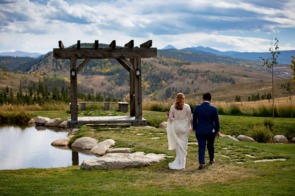 Granby-Colorado-Strawberry-Creek-Ranch-Wedding-Fire-on-the-Mountain-Wedding-Pops-of-Color-Fire-hot-colors-bride-and-groom-walking-to-gazebo