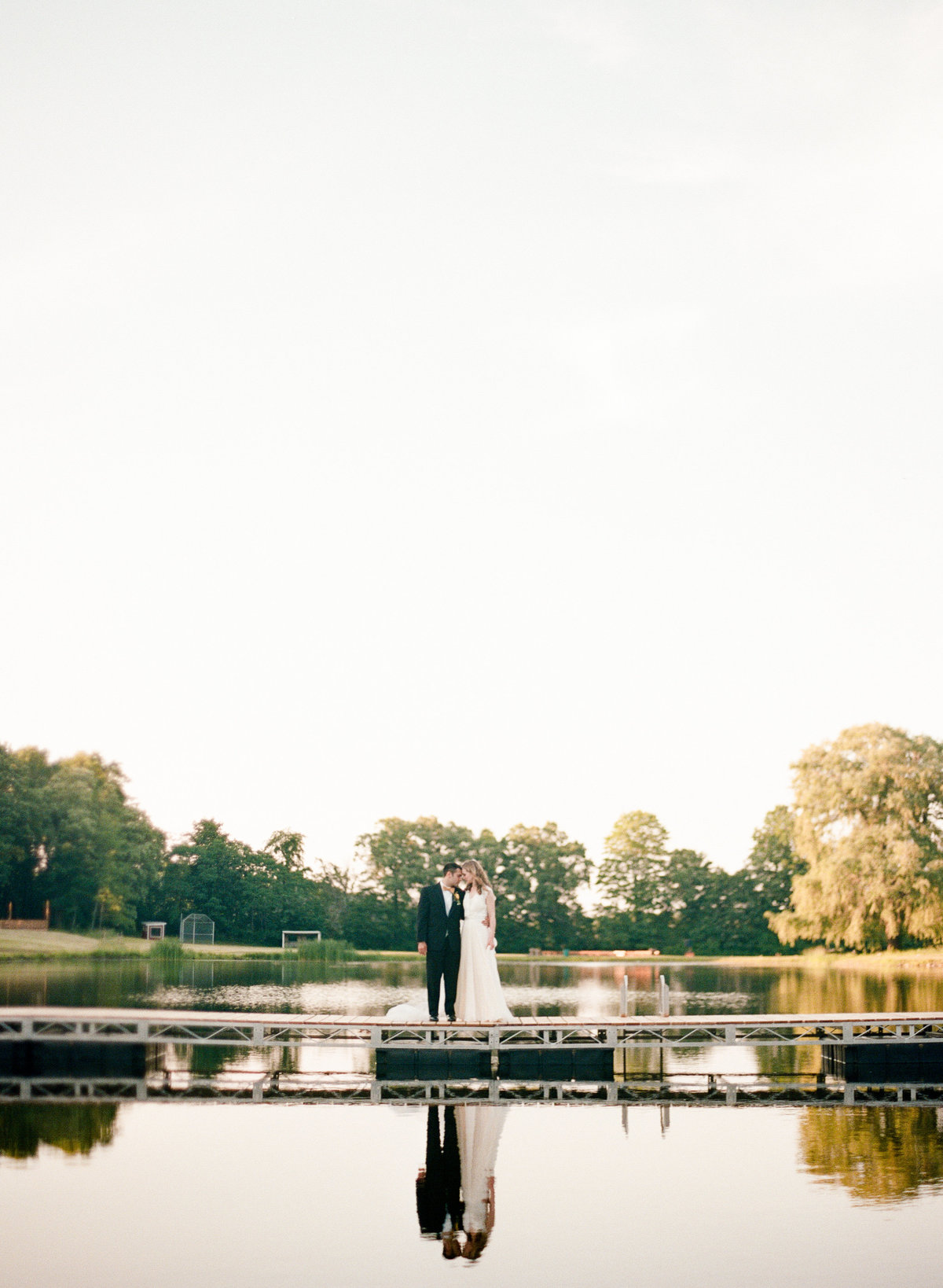 new york camp wedding couple on dock new york wedding photographer