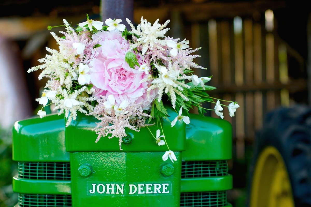 DIY wedding bouquet on John Deere tractor