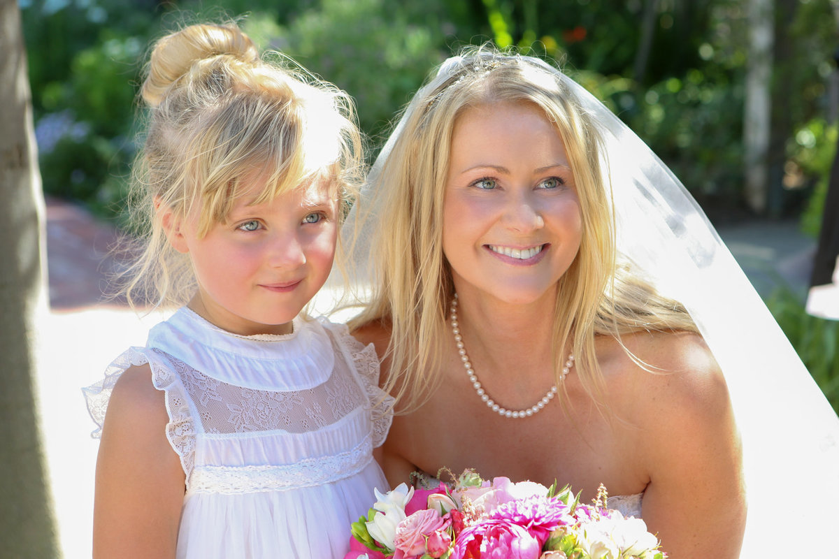 Close-up portrait of bride and flower girl, california outdoor wedding