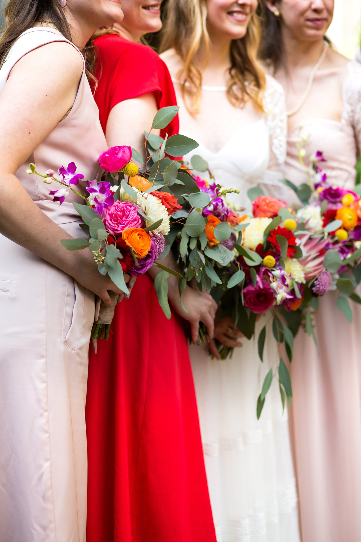 bold wedding flowers and bridesmaids photo at the Poe Museum wedding in Richmond.. Richmond  wedding photographers