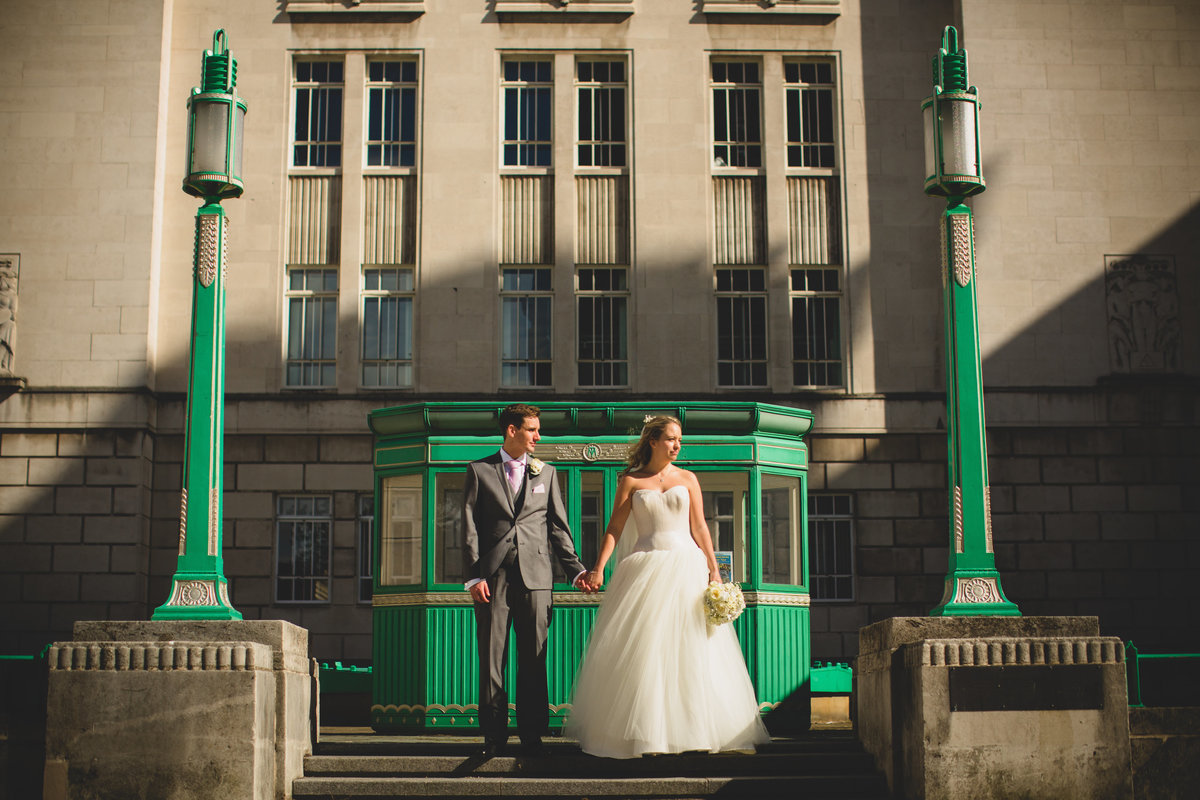 couple in liverpool in front of green building. city centre wedding photo